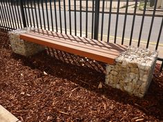 Rockweld seats made out of welded mesh and rock can act as a retaining wall as well as a functional and interesting feature in a garden or park.