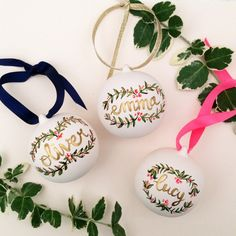 These beautiful hand painted  ceramic baubles can be personalised in gold ink with a hand lettered name which is encased within a beautiful handprinted wreath.  Ribbons area available in gold, neon pink or navy blue.  The perfect gift for a loved one or to celebrate a special occasion.