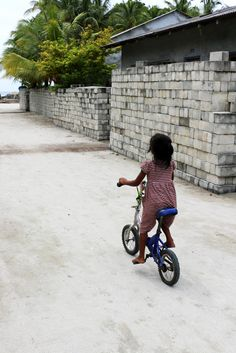 Little girl riding a bicycle  #bike #Maldives