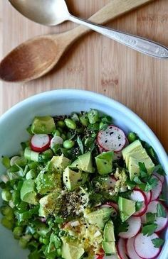 This yummy salad is SO easy to make! Made with avocado, radishes, edamame and green onions.  Add dressing and sprinkle sesame seeds on top.