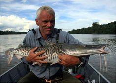 I love river monsters! This is Jeremy Wade, star of the show, with catfish.