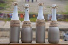 Repurpose your wine bottles for decor! Spray paint, jute string, sequin ribbon.