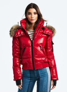 Young model in glossy red padded half length puffer coat with fur trimmed hood. Down Puffer Coat, Down Coat, Puffer Coats, Ski Fashion, Winter Fashion, Nylons, Puffy Jacket, Jacket Style, Winter Jackets