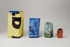 Paper bag waste baskets. Joris van der Meulen. Bags are made of unused billboard posters. DDW 2012