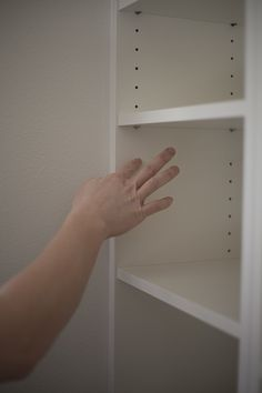 DIY Ikea Billy Bookcase Built In Bookshelves Part 2 - Run To Radiance - use caulk to fill-in the unneeded holes on prefab bookcases.