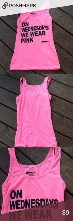 On Wednesdays We Wear Pink. Mean Girls Tank. On Wednesdays We Wear Pink Tank. A classic line from the best girls night in movie ''Mean Girls''. Graphic Tank.Writing in Black. A must for any mean girl fan out there. Please note, there are four stains just below the words near bottom. Size:M 57% Cotton. 38% Polyester 5% Spandex. Price is low and firm due to stains. No Trades. No Holds. Not Brand Listed Hollister Tops Tank Tops