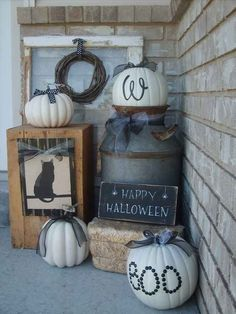 White lettered pumpkins with silver ribbon