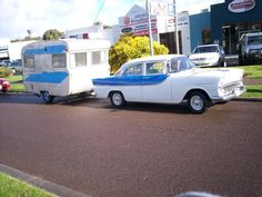 Early-mid 1960s Viscount Valiant caravan towed by matching Holden, NSW