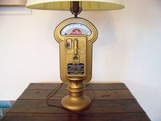 """Parking Meter Lamp - I bought one of these in the 1980s. I was told that the city of Chicago donated its old meters to the Boy Scouts club there and the teenagers retrofitted them to be lamps and sold them as a fund-raising project. Nickels or dimes """"feed the meter"""" for up to an hour of light; when the meter runs down, the light clicks off. Quite a conversation piece. :-)"""