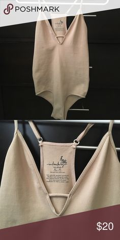 Free People Bodysuit NWOT Nude colored, super soft bodysuit from Free People intimately! Features adjustable straps, plunge neck line, and racerback. 92% nylon, 8% spandex. Free People Tops