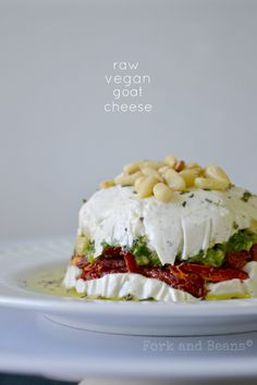 A vegan cheesy dip made from cashews and layered with pesto and sundried tomatoes. No one will know it's made from nuts!