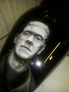 Photo realistic painting of Frankenstein on a Sporster gas tank.