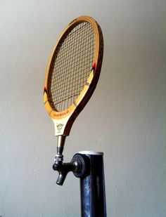 Not sure if this should go with food and fun or home ideas. ;-) Either way it's fully awesome. tennis racquet beer tap