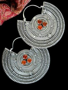 Spectacular large Sterling Silver and Carnelian Earrings handcrafted by Tibetan Tribal Jewelry artisans living in exile in the Tibetan Diaspora of Nepal. Skillfully crafted to reproduce antique tribal jewelry.