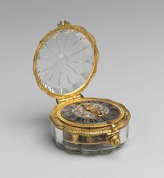Watch; Watchmaker: Jean Rousseau (1606–1684); Date: ca. 1650–60; Culture: Swiss (Geneva); Medium: Case: rock crystal and gilded brass; Dial: silver, enamel