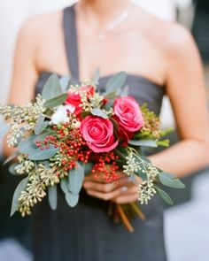 These bridesmaids carried bouquets of 'High and Fantasy' roses, brunia, freesia, seeded eucalyptus, and pepperberries