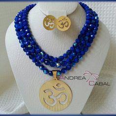 Diseño Andrea Cabal Accesorios I-012 Cristales y murano checo.  Dije en Bronce con Baño Oro 24k.