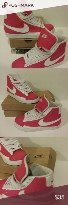 Nike pink glitter and whitesneakers shoes high top Nike blazer mid sneakers. Size 5.5y Fabric is pink with glitter sprinkled throughout and white patent swoosh. Very good pre-owned condition. Comes with original box. Nike Shoes Athletic Shoes