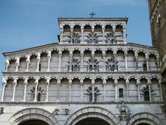 The arcading on the facade of Lucca Cathedral, Tuscany, (1204) has many variations in its decorative details, both sculptural and in the inlaid polychrome marble.