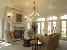 """""""Renaissance"""" stone fireplace mantel from Francois & Co in a living room by Hendel Homes"""