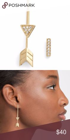 """REBECCA MINKOFF Mismatched Arrow Earrings A fashionably mismatched earring set lets you adorn one lobe with a trendy arrow drop and the other with a simple, crystal-encrusted bar stud. - Gold tone plated glass detailed mismatched arrow earrings - Post back - Approx. 2 1/4"""" drop, 1/4"""" width drop earring - Approx. 3/8"""" drop, 1/8"""" width stud Materials Gold-tone metal, glass Rebecca Minkoff Jewelry Earrings"""