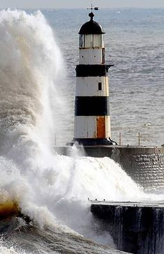 Lighthouse with rushing waters.