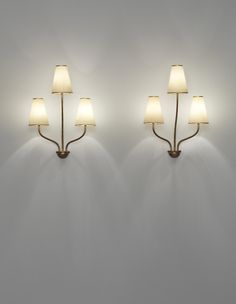 JEAN ROYÈRE Pair of 'Persane' three-armed wall lights, circa 1953  Painted and gilded tubular metal, painted and gilded metal, paper shades (2). Each: 54 x 39 x 30 cm (21 1/4 x 15 3/8 x 11 3/4 in)