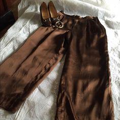 Gucci silk slacks Gucci brown silk slack gold Gucci button wide bottom slack ,beautiful 💕💕fit like a size 4 Gucci Pants Straight Leg