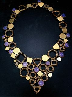 Todd created this stunning necklace in 2004. It's eighteen and twenty-two karat yellow gold, sterling silver with patina, raw diamond cubes and blue chalcedony.