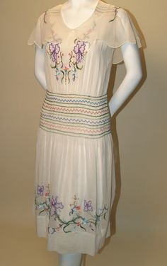 LATE 1920s VINTAGE WHITE VOILE DROP WAIST DRESS WITH POLYCHROME EMBROIDERY AND SMOCKING. Available at rpvintage.com