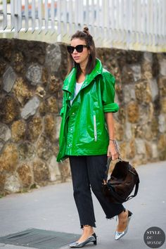 visual therapy shares rainy day street style tips. Seen here: green vinyl jacket, raw edge jeans and metallic kitten heels.