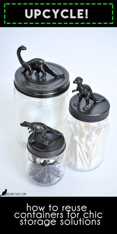 upcycled glass jars with little plastic dinosaur toys = chic storage solution in a boys bathroom