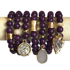 Color: Plum Speck  This rich jade stone is a perfect color for winter and mixes with so many color outfits. Beads measure 10mm and are strung on a thick elastic cord. One size fits most comfortably - however, smaller or larger bracelets can be made upon r