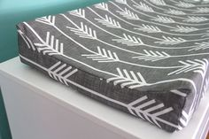 I LOVE all her fabrics! So cute, her entire etsy site.  charcoal arrow contoured changing pad cover by iviebaby on Etsy, $35.00