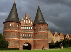 The Holstentor is one of the two remaining city gates of the city of Lübeck. Built in 1464, the gate now serves as a museum. Because of its two captivating round towers and arched entrance it is regarded as a symbol of Lübeck. Together with the old city center (Altstadt) of Lübeck it is one of the top tourist attractions in Germany.