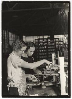 Lewis Wickes Hine, [Two workers stamping glass jars with new device for lettering painted bottles, T. C. Wheaton Company, Millville, New Jersey], March 1937
