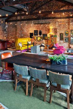 The lobby has brightly colored retro-fabulous furniture, exposed brick walls and whimsical artworks. #Jetsetter
