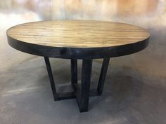 Butcher Block Style Round Table with Metal by MetalTreeFurniture, $799.00 This would look great with a white or cherry stain on the wood