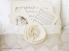 Closeup: Vintage Pocket Pillow, $49.00 + Ship -  This is a vintage pocket pillow that has been  created from a vintage piece of fabric, lace,  mother of pearl vintage buttons, a rose, vintage music sheets and a vintage photograph ~ It measures 19 x 19 inches ~ The insert is feather/down and is removable ~  http://www.katiesrosecottagedesigns.com/item_1903/Vintage-Pocket-Pillow.htm  (03.09.13)