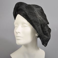 Poet style oversized slouch beret created with a soft woven black straw (side view)   United States, 1940's   Unstructured style, so many creative ways to wear