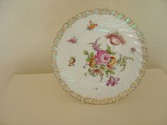Vintage hand painted Dresden china plate with traditional summer flower patterns fluted gilded edge. on Etsy, $20.71