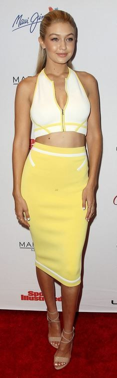 Gigi Hadid:  Shirt and skirt – David Koma  Shoes – Brian Atwood
