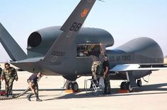 USAF DRONE - GLOBAL HAWK RQ-4 - CLOSE UP LOOK AT MECHANICS WORKING ON ENGINES