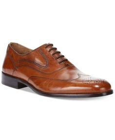 Rather than wander, take flight in dapper wing-tips by Johnston & Murphy. | Leather upper; leather sole | Imported | Johnston & Murphy men's oxfords | Wing-tip toe | Broguing details | Lace-up closure