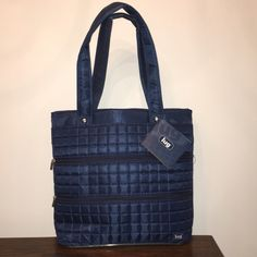 """Lug Taxi - Full Tote Bag Lug Life Bag!  Color is """"Taxi- Navy Blue"""". Measurements are 16.5""""w x 13"""" h x 5"""" d.  Tons of zippers and compartments inside and out!  Also has a small zipper bag included inside, 4.5"""" x 3.5"""" and a mirror.  Great bag!!  I also have this in green and pink.  No trades. Lug Bags Totes"""
