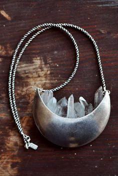 Quartz & Crescent Necklace - Pamela Love, it looks like a little crystal city nestled in a crescent moon :)