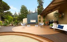 The addition of lighter colored decking in a circular pattern creates an ideal spot for sitting and relaxing with friends on this amazing Trex outdoor living space. Outdoor Living Areas, Outdoor Rooms, Wpc Decking, Composite Decking, Back Porch Designs, Wood Plastic, Deck Flooring, Deck Steps, Deck Pictures