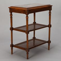 French Tiered Side Table with Marble Top and Caned Shelves  --  Circa 1920s French side table has marble insert table top, turned wood legs and two lower caned shelves. Excellent antique condition.  --   Item:  6781  --  Retail Price:  $1495