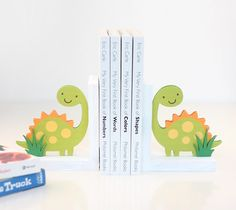 Dinosaur Book Ends by Damask Love. Make It Now with the Cricut Explore machine and Print then Cut feature in Cricut Design Space.