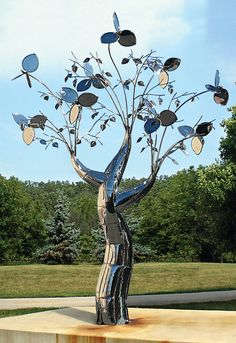 """Mark Baltes' """"Aero Agoseris"""" is a large kinetic sculpture shaped like a dandelion in steel and aluminum, towers 15 feet - a weather vane seed head in the act of dispersal. Description from pinterest.com. I searched for this on bing.com/images"""
